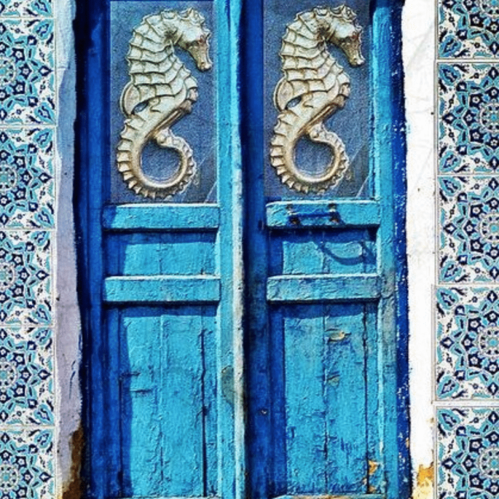 House with blue seahorse doors