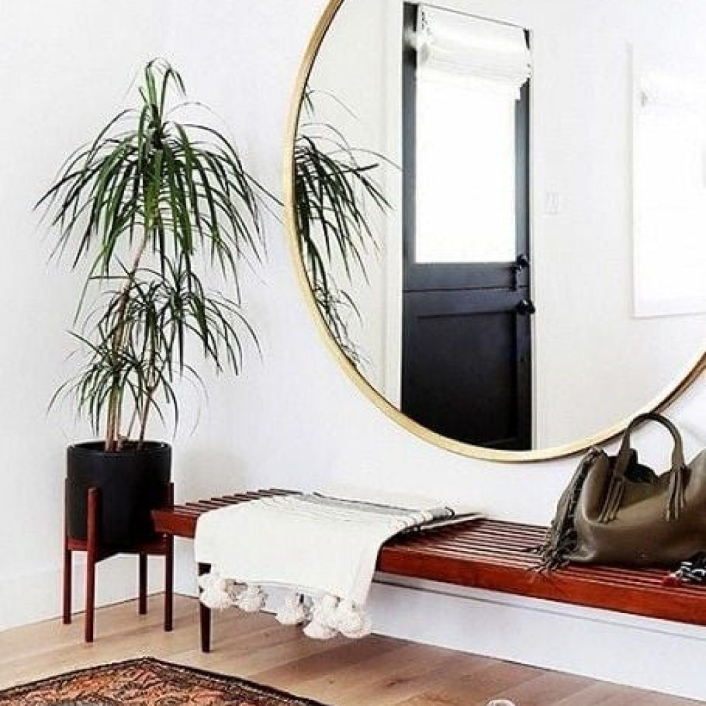 Round mirror mounted on wall