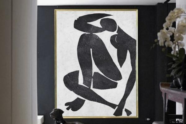 Black Labrador retriever near the abstract painting