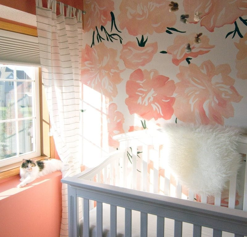 White wooden crib in front of window