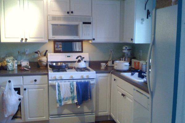 White gas range oven inside kitchen