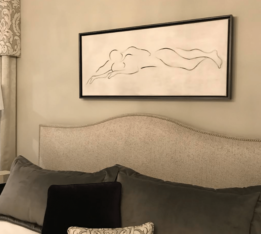 Four gray and black bed pillow inside bed room