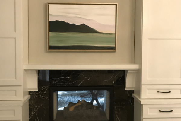 Turned-off black electric fireplace inside white-painted room