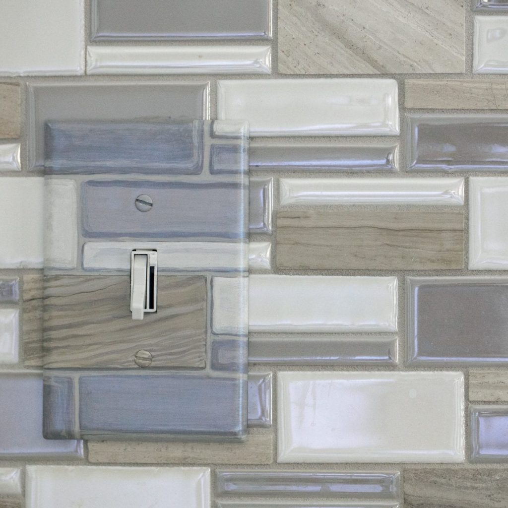 Gray and beige light switch