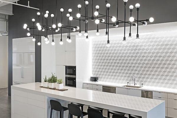 Eight black bar stools on white wooden kitchen counter