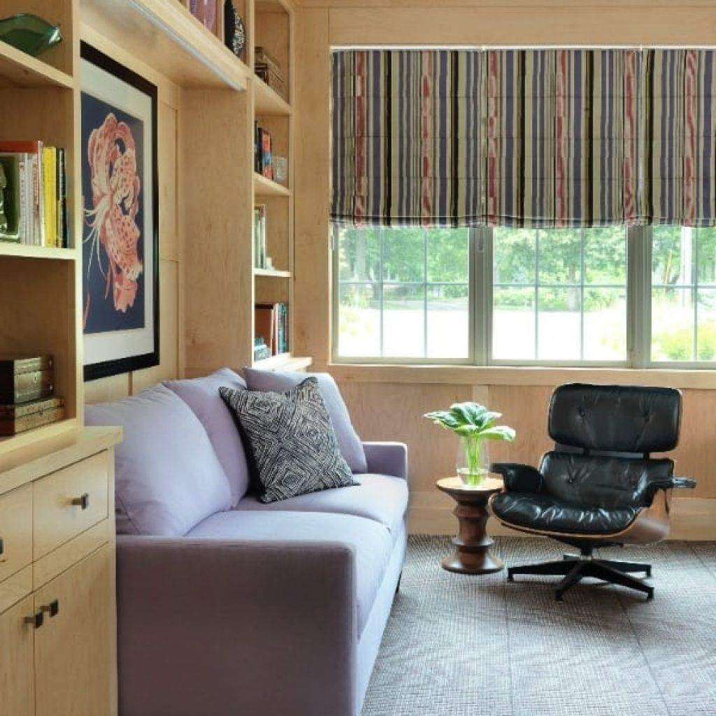 White fabric 2-seat sofa behind brown wooden cabinet
