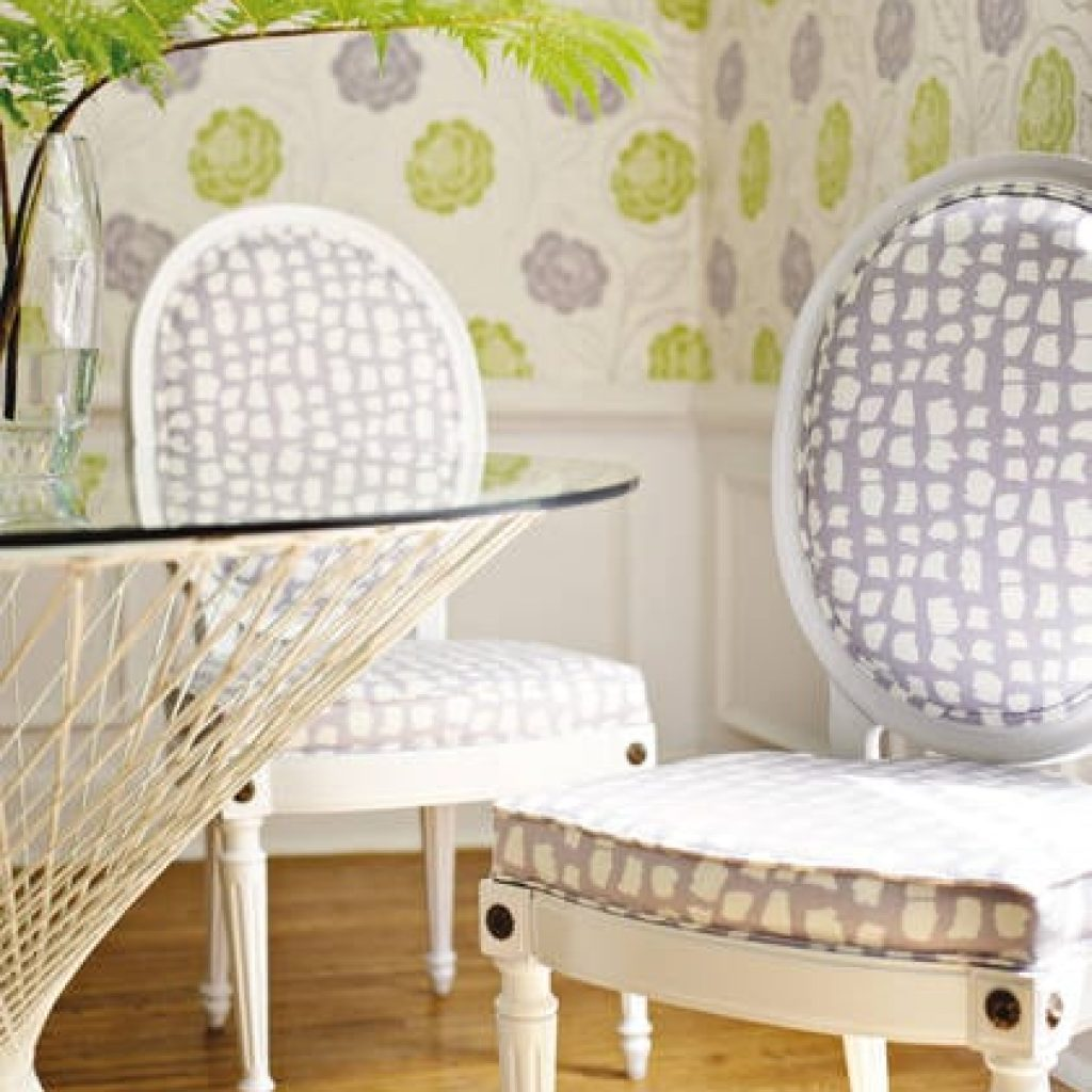 Two white wooden chairs infront of table