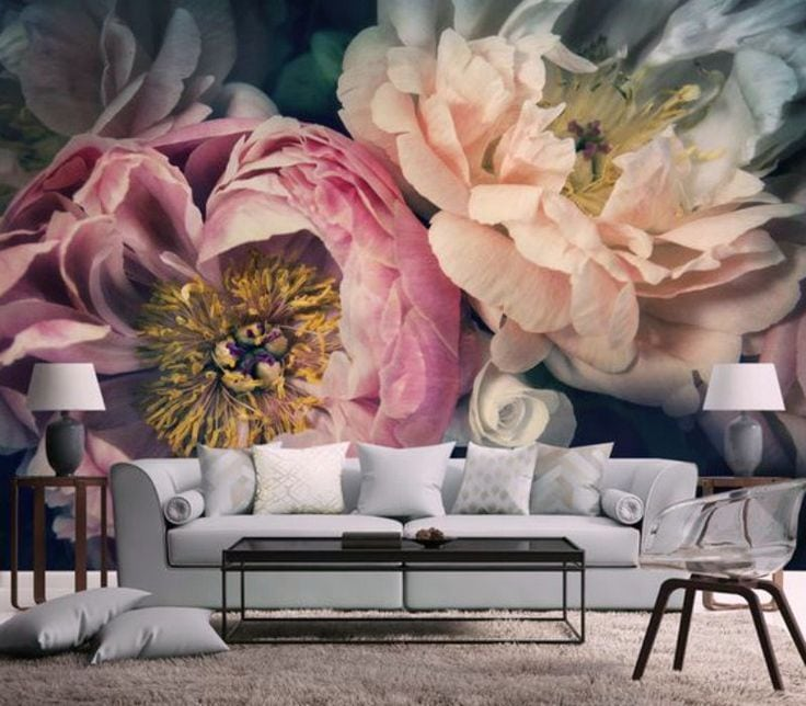 White 2-seat couch beside flower wallpaper