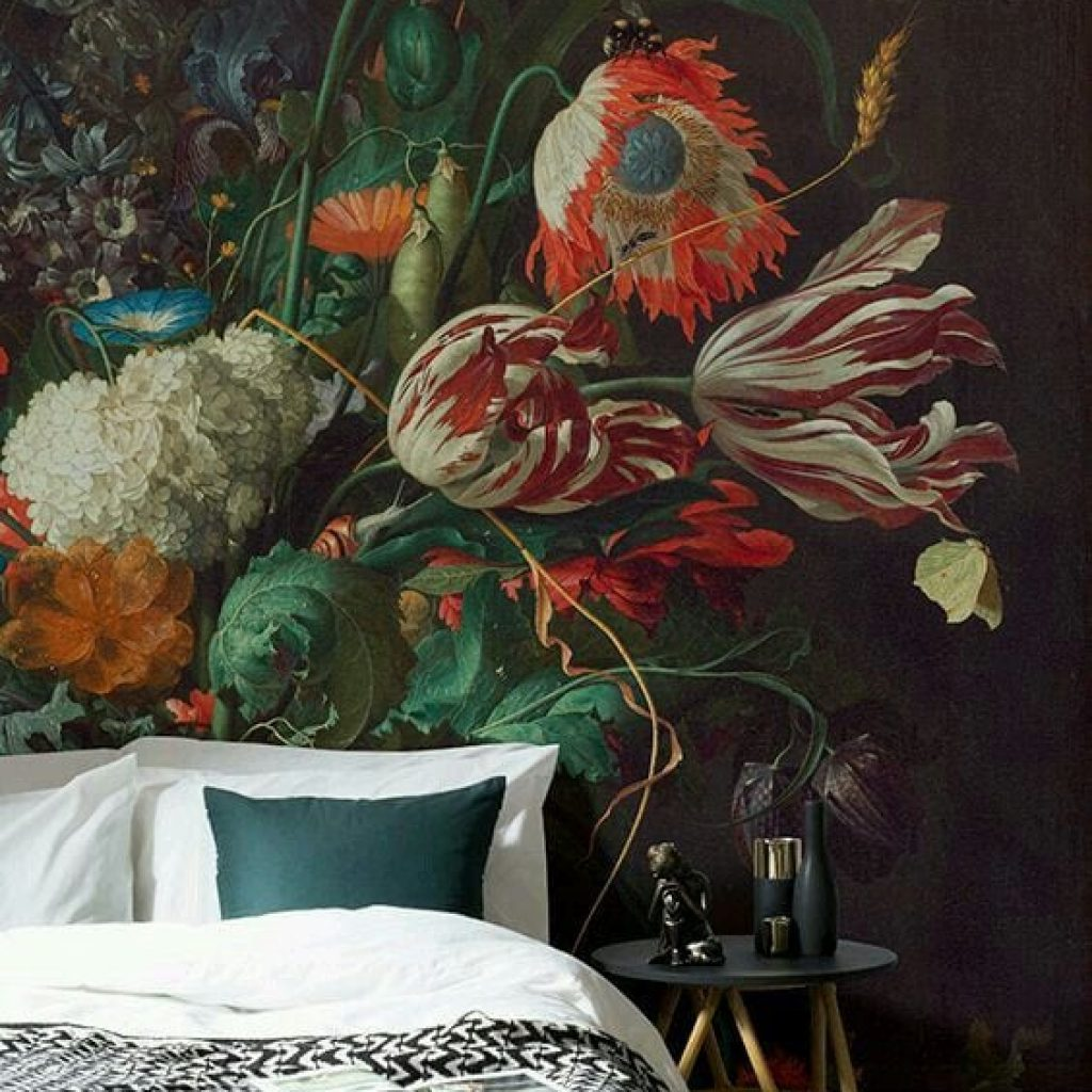 White and red petaled flower mural over bed