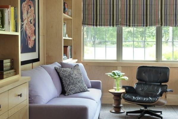 Brown fabric loveseat near brown wooden shelf