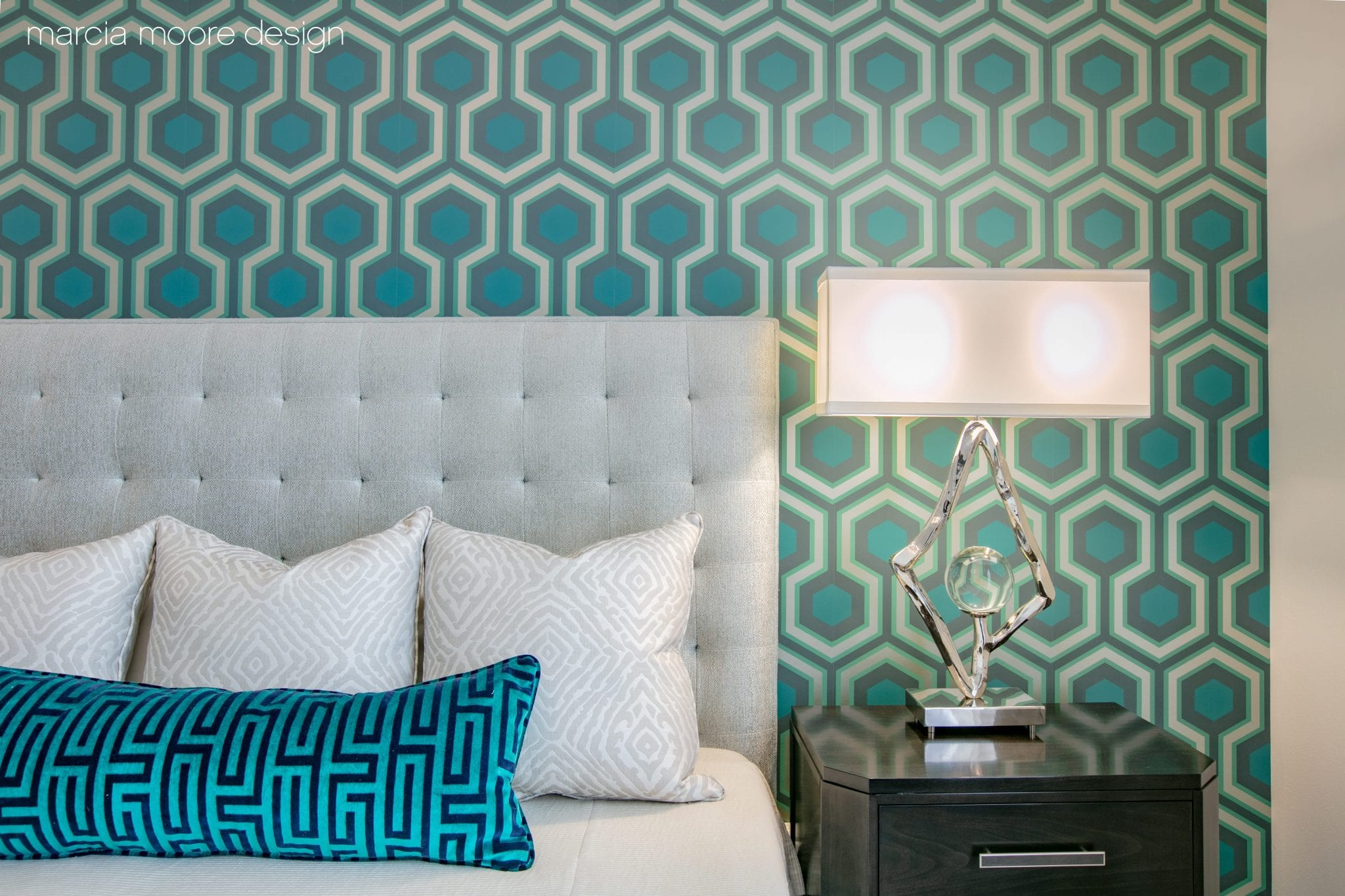 Blue and teal pillow on bed