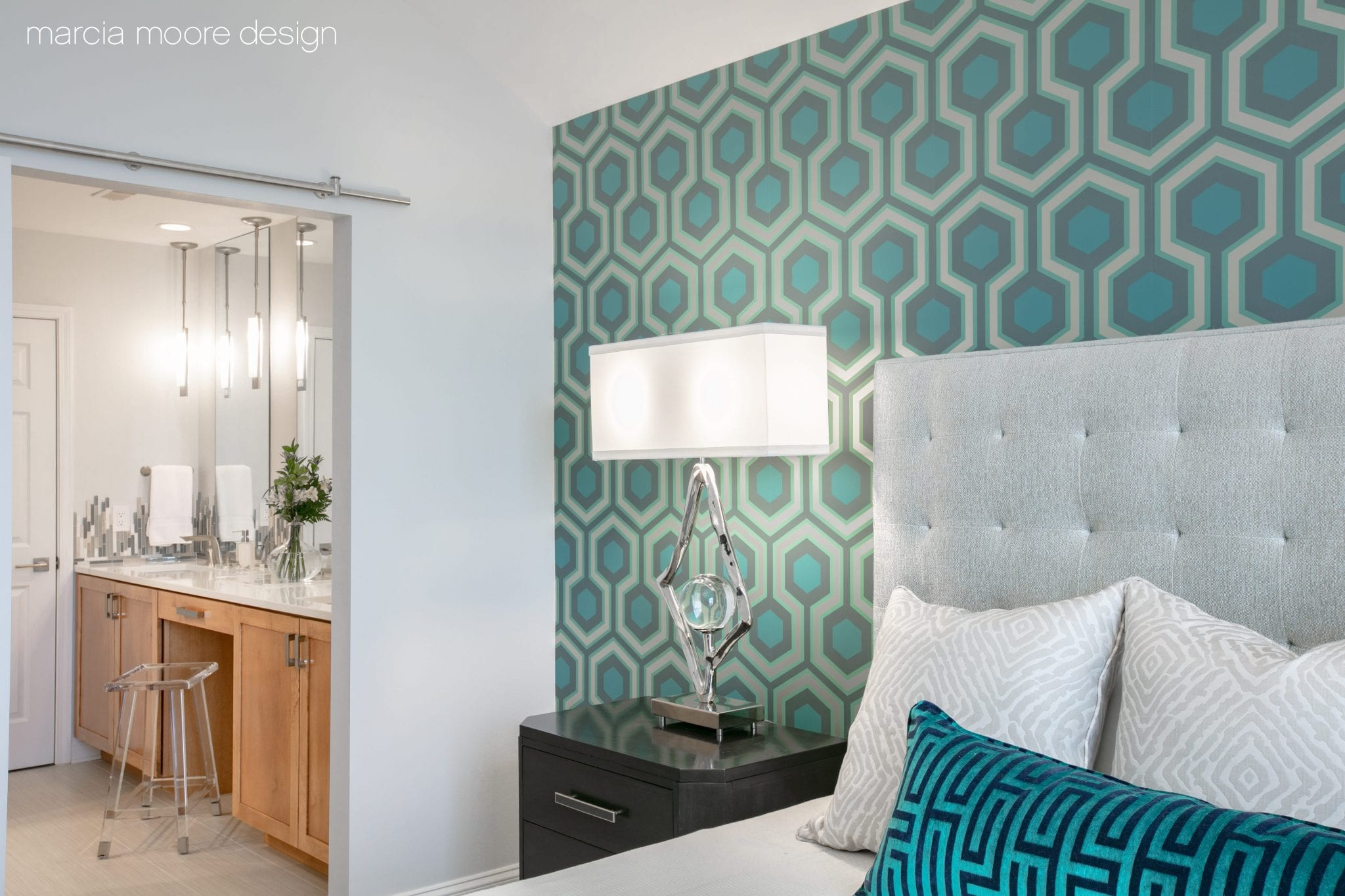 Teal and white pillows on the bed