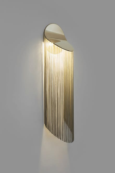 fringed sconce in gold