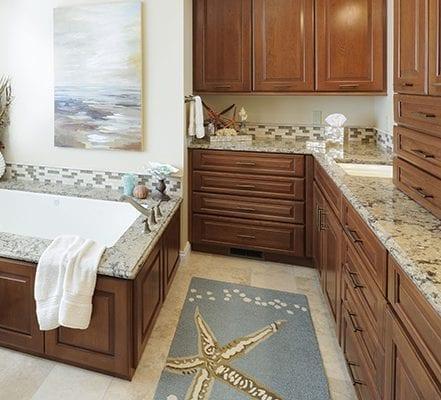 Bathtub near cabinet and area rug