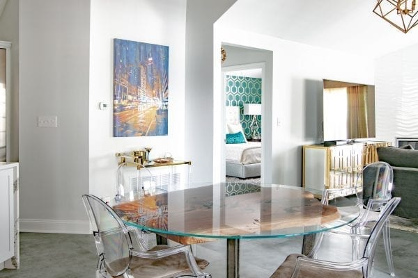 Clear glass-top table with four chairs dining set