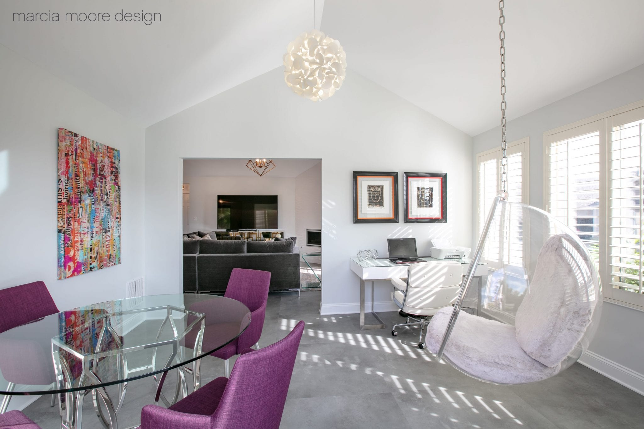 Oval glass-top table with gray base and purple chairs