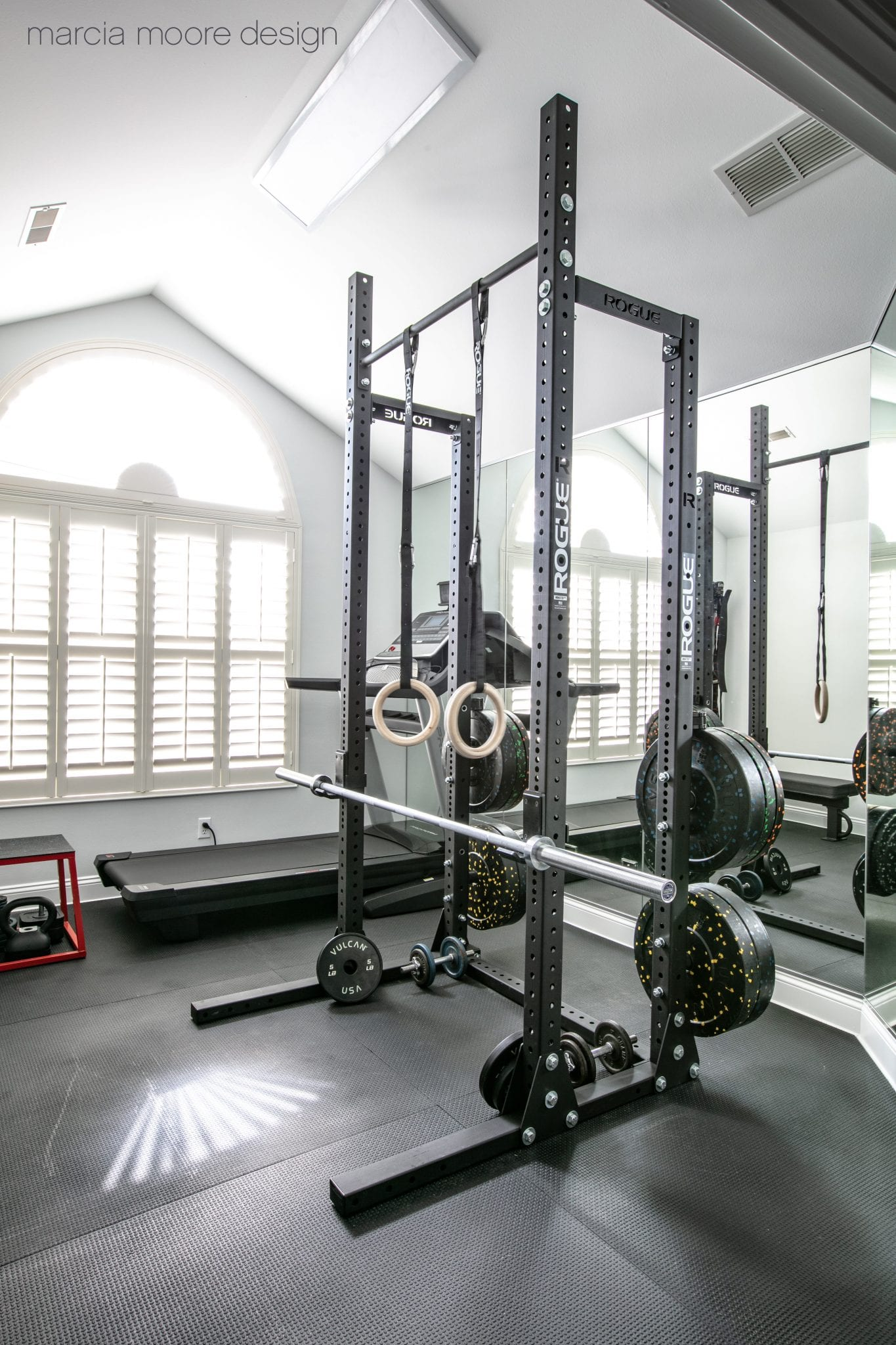 Black and gray exercise equipment inside room
