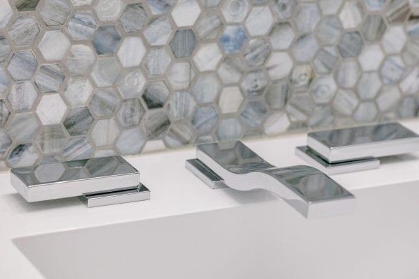 Silver faucet selective-focus photography