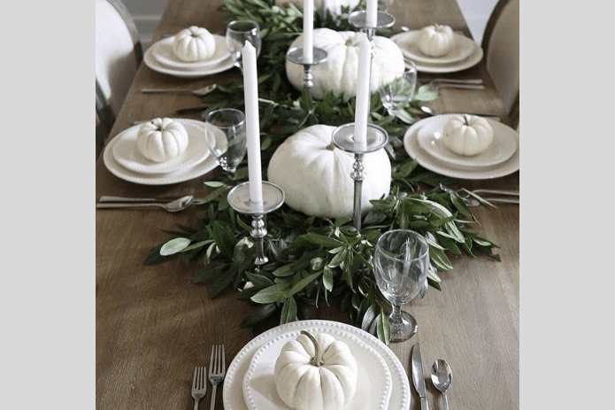 white pumpkins along table
