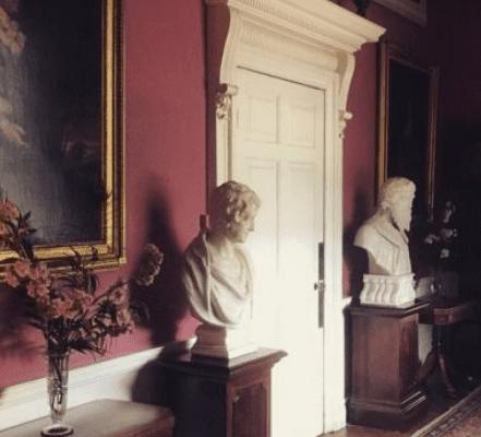 white busts in aubergine hallway