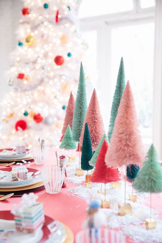 brightly colored trees as centerpieces on a table