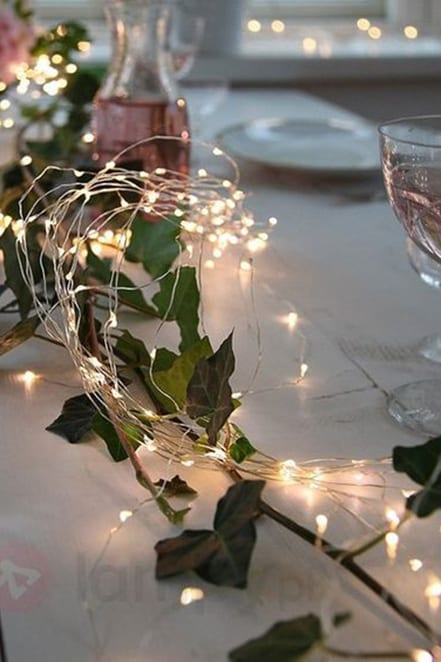 lights along a white tablescape