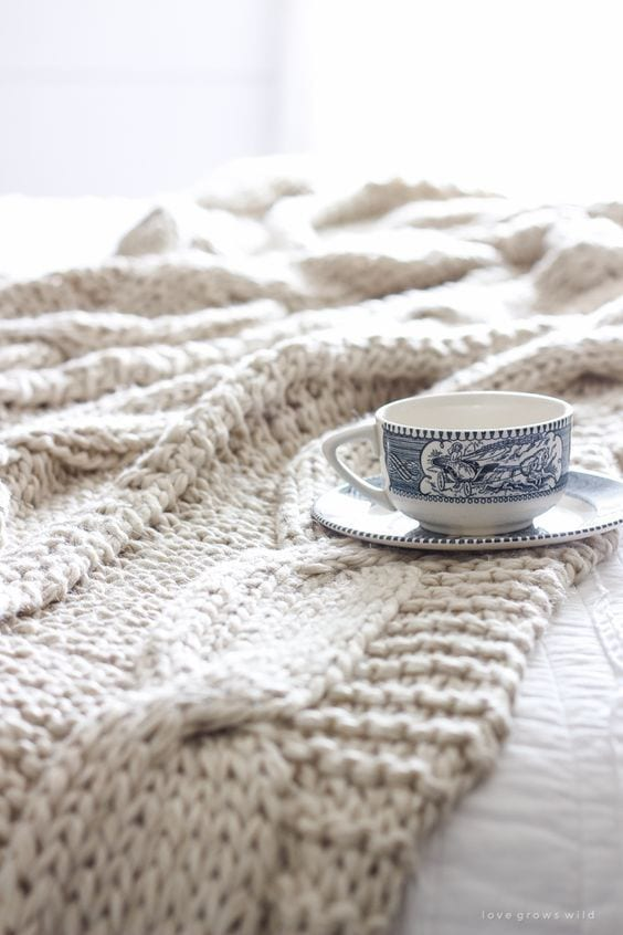 coffee cup on blanket