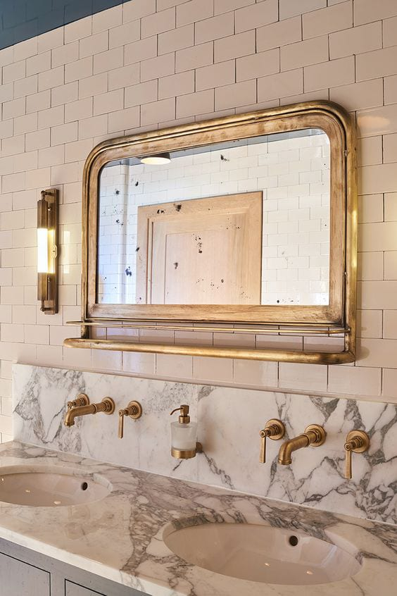 gold mirror in bathroom
