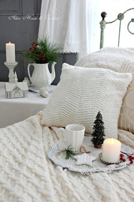 white bed with candle