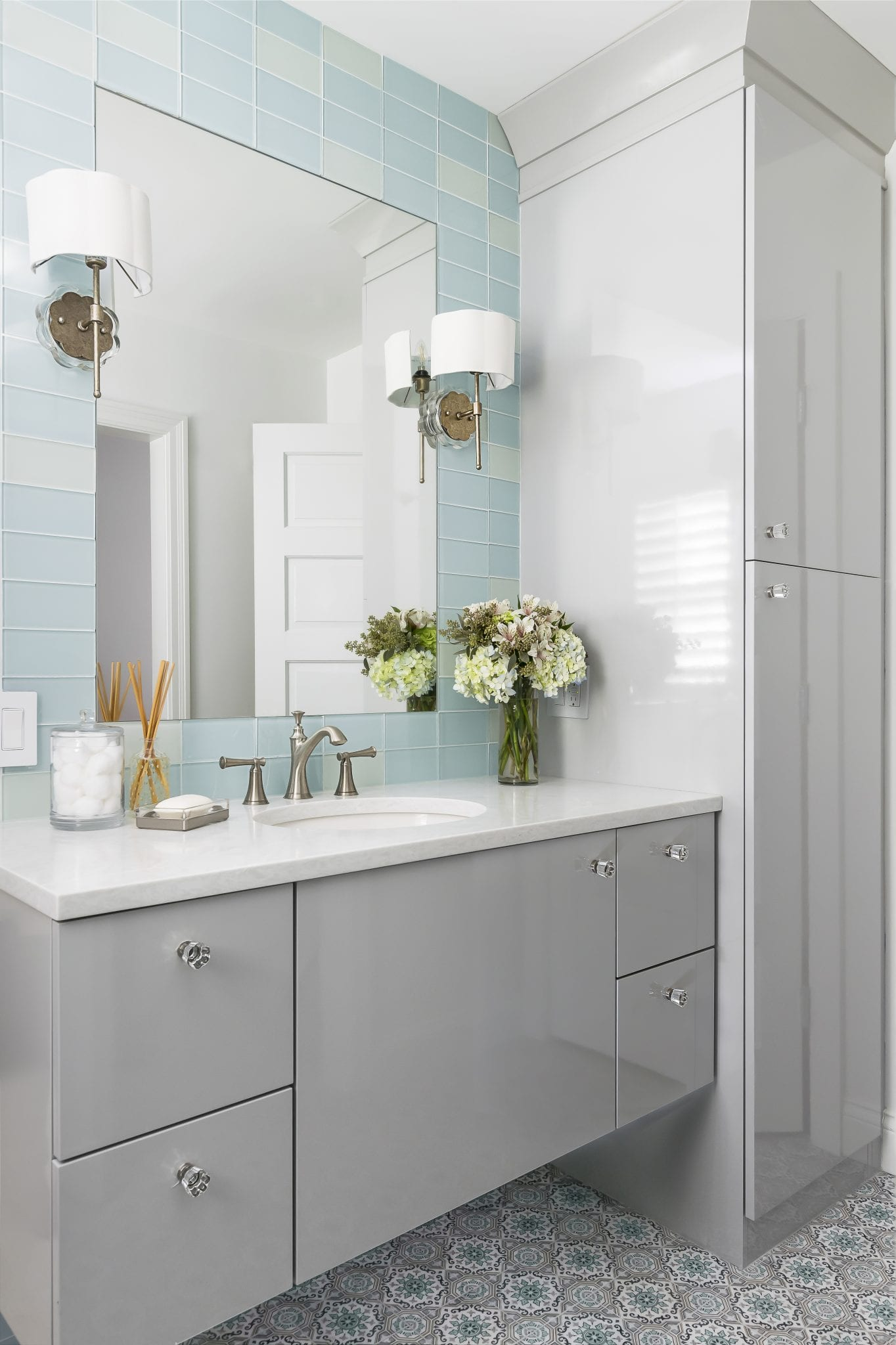 gray cabinetry in bathroom